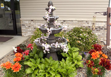 Fountain in a flower garden | Respite Services