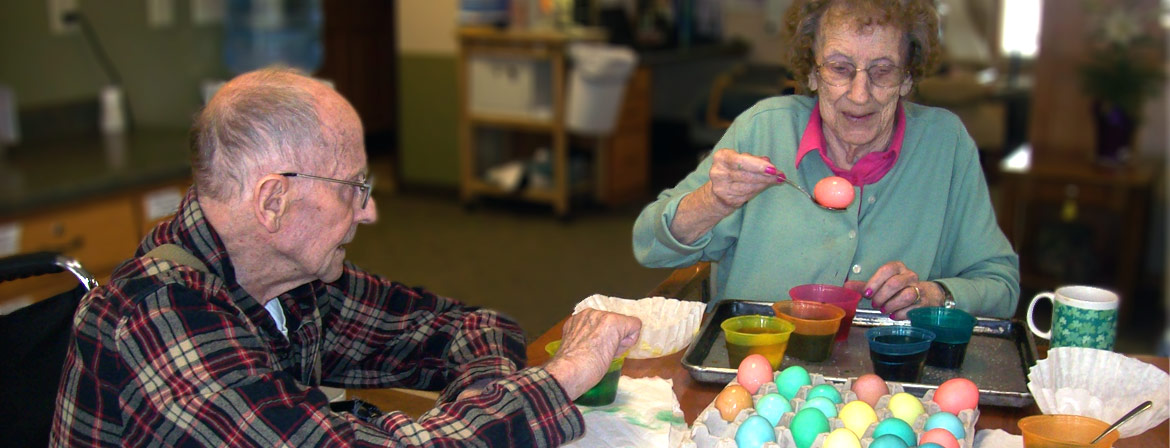 Assisted Living residents coloring Easter eggs